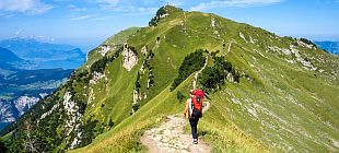 woman hiking up a mountain path