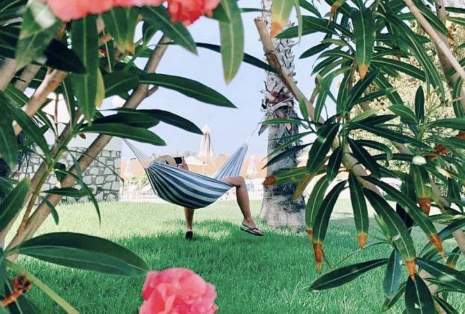 A man relaxing in a hammock