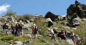 Group of walkers in a rocky area during their holiday in Las Alpujarras & the Sierra Nevada